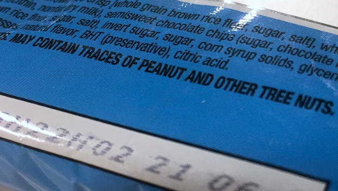 "This Nov. 30, 2016, photo shows part of a food label that states the product ""may contain traces of peanut and other tree nuts"" as photographed in Washington. A new report says the hodgepodge of warnings that a food might accidentally contain a troublesome ingredient is confusing to people with food allergies, and calls for a makeover. The report from the prestigious National Academies of Sciences, Engineering and Medicine said it's time for regulators and the food industry to clear consumer confusion with labels that better reflect the level of risk."