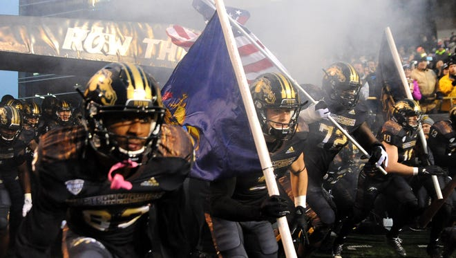The Western Michigan Broncos enter the field before the first half against the Toledo Rockets at Waldo Stadium.