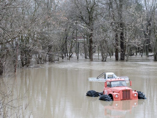 Two Vehicles In A Field Covered By Flood Water New Palestine After Heavy Rainfall Brought