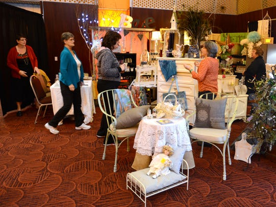 Potential customers browse the Aunt Bee's House booth at last year's Mid-Willamette Valley Women's Show. The event returns Feb. 5-6.
