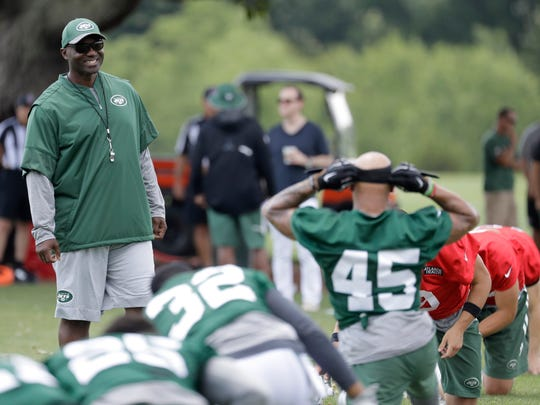 New York Jets head coach Todd Bowles, left, looks on