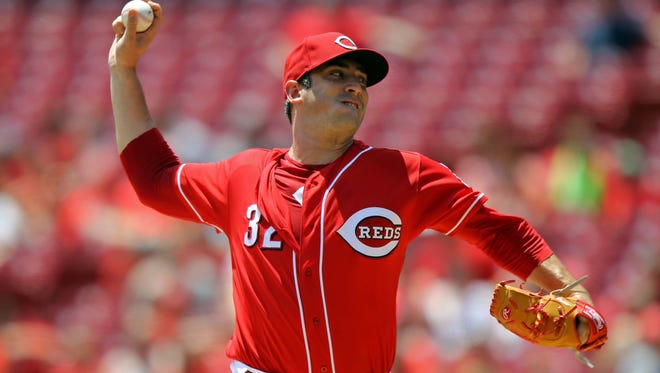 Cincinnati Reds starting pitcher Matt Harvey throws against the Milwaukee Brewers in the first inning at Great American Ball Park in Cincinnati, Ohio, on Sunday, July 1, 2018.