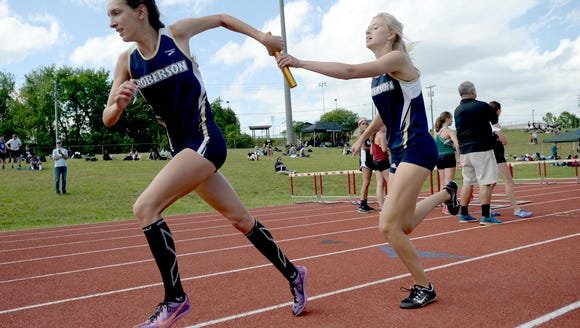 Roberson's Elise Wright takes the handoff from Ashlyn