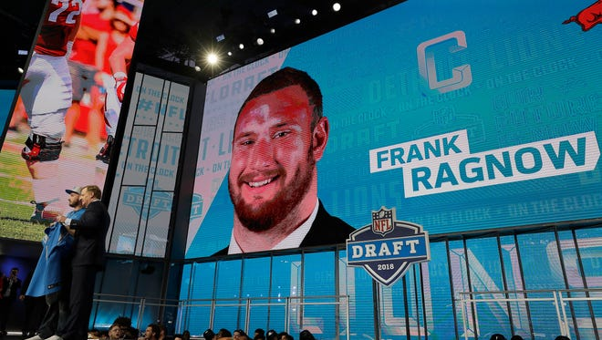 Commissioner Roger Goodell, left, poses with a fan after the Detroit Lions selected Frank Ragnow during the first round of the NFL Draft on Thursday.