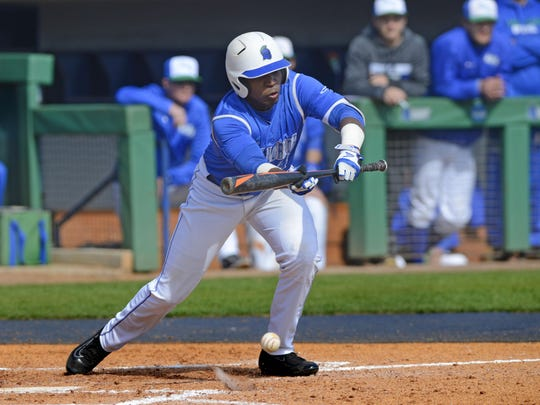 West Florida's Ladeavon Matthews lays down the bunt Sunday at Jim Spooner Field. West Florida went on to beat Tampa 1-0.