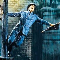 "Gene Kelly is ""Singing in the Rain."""