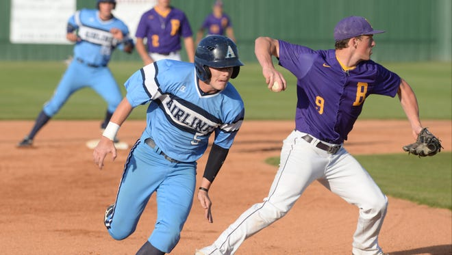 Hayden Waxley makes his way to third to load the bases as third baseman Steel Netterville misses the tag in the first inning of Airline's 5-3 win earlier this season.