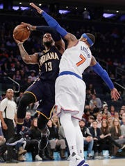 Indiana Pacers' Paul George (13) is defended by Knicks' Carmelo Anthony (7) during the first half of a game, Tuesday, March 14, 2017, in New York. The Knicks won, 87-81.