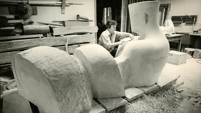 "Nita Sunderland works on ""Recumbent Knight"" in her studio in 1978."