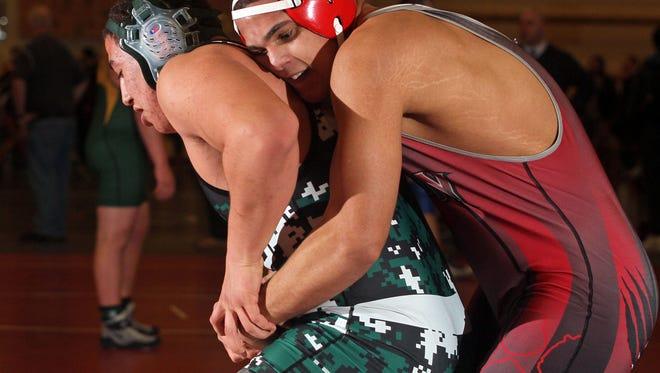 This is action of Region V wrestling at Hunterdon Central High School in Flemington.
