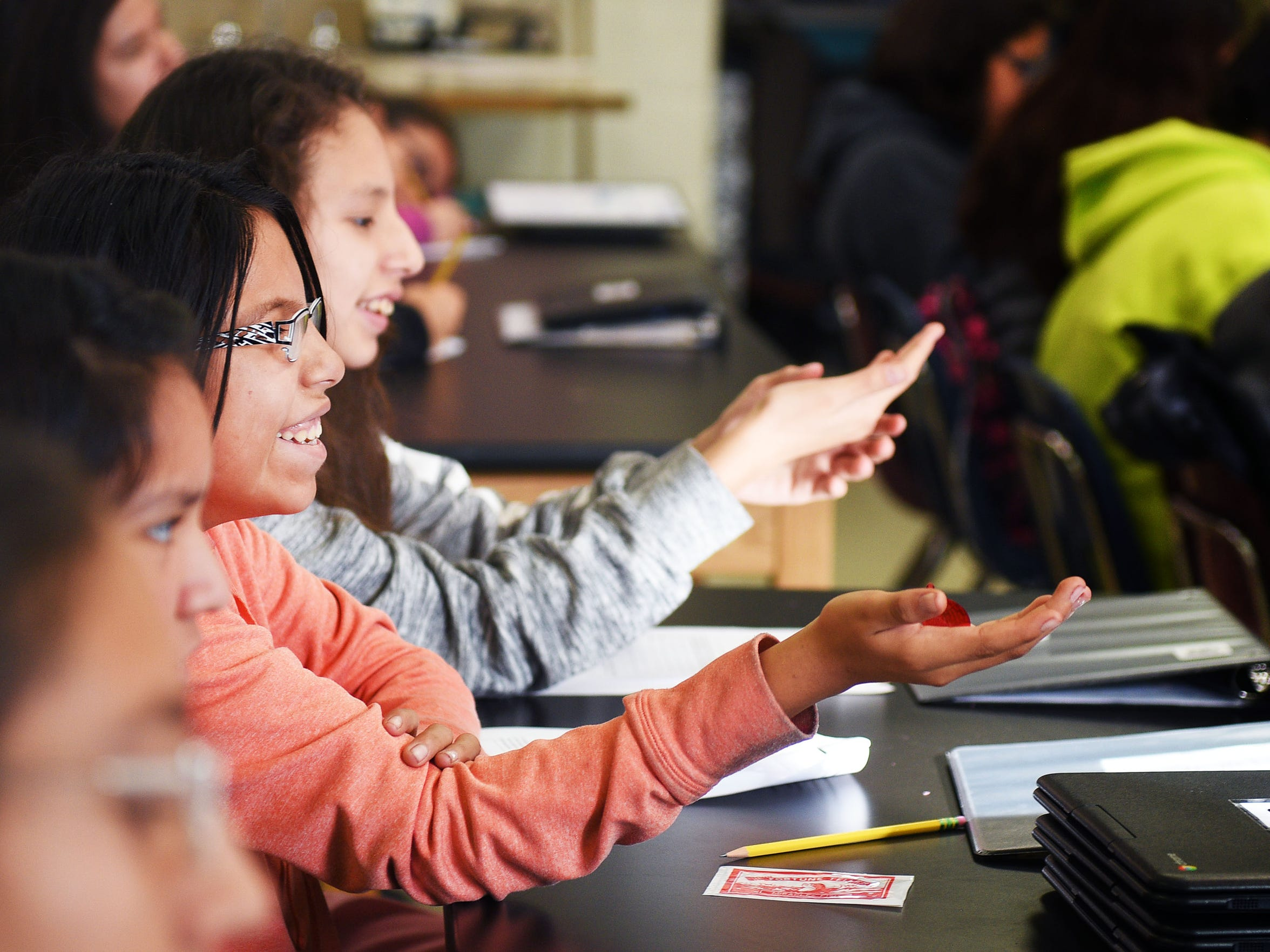 Todd County Middle Schooler Simone Iron Shell holds out her hand during a demonstration about friction in Kaelee Krege class Tuesday, Nov. 14, in Todd County, South Dakota.