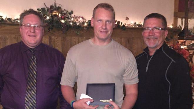 Wisconsin Rapids Patrol Officer Dan Pelot, center, received the Modern Woodmen Hometown Hero award on Oct. 18 at Lake Aire Supper Club. Also pictured are Curtis Langemeier, local Modern Woodmen volunteer leader, left, and Wisconsin Rapids Police Chief Kurt Heuer.
