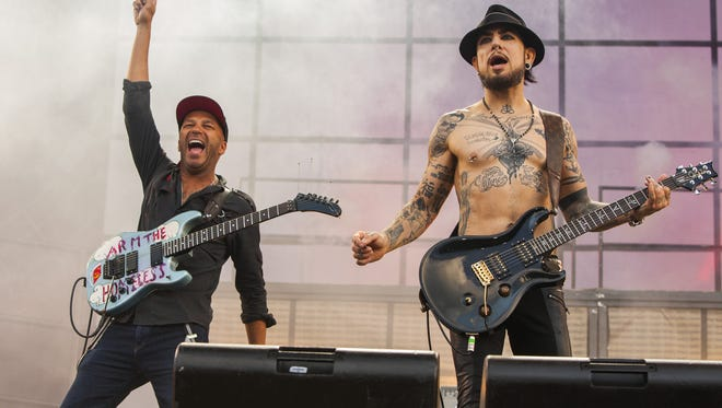 Tom Morello with Dave Navarro of Jane's Addiction work the crowd Saturday at Lollapalooza in Chicago.