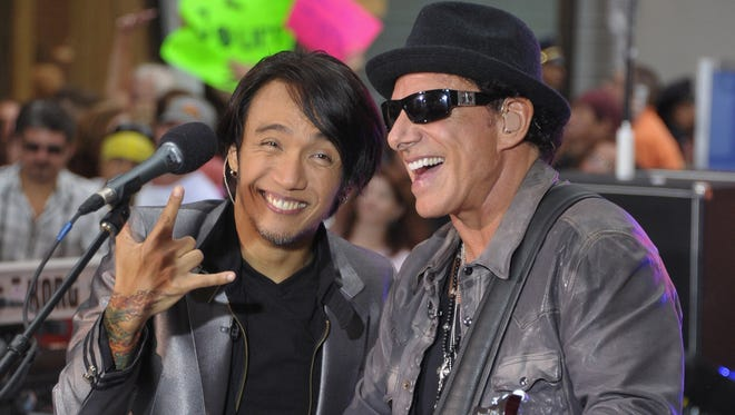 Singer Arnel Pineda and guitarist Neal Schon of Journey performs at New York's Rockefeller Plaza in 2011.