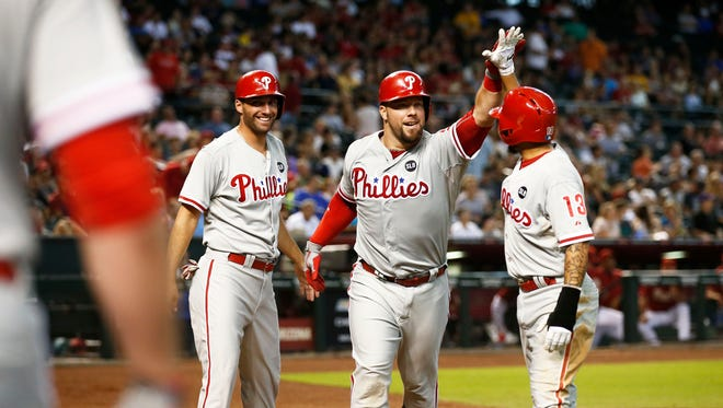 Philadelphia Phillies Cameron Rupp celebrates his 3-run homer, driving in Francoeur and Galvis (right) against the Arizona Diamondbacks against the in the 6th inning on Wednesday, Aug. 12, 2015 at Chase Field in Phoenix, AZ.