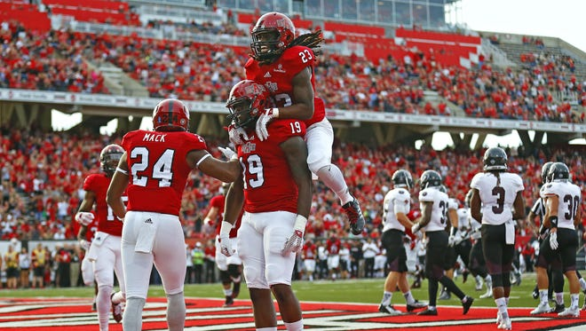 Arkansas State tight end Darion Griswold (19) and wide receiver JD McKissic (23) celebrate after Griswold scored a touchdown against Missouri State at Centennial Bank Stadium in Jonesboro, Ark., on Saturday night.