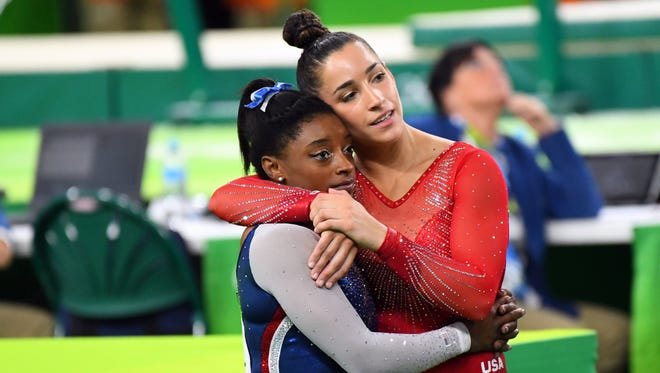 USA gymnasts Simone Biles (left) and Aly Raisman finished first and second, respectively, in the all-around competition.