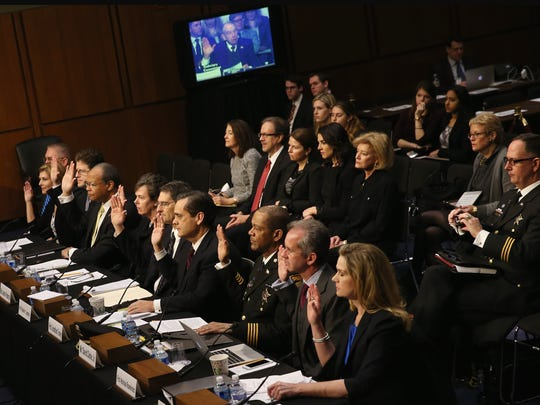 Character witnesses for Loretta Lynch raise their right