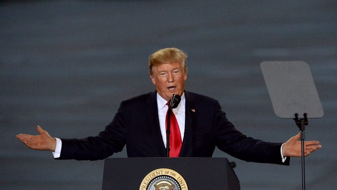In this file photo, President Donald Trump addresses the crowd in an Air National Guard hangar in Harrisburg.