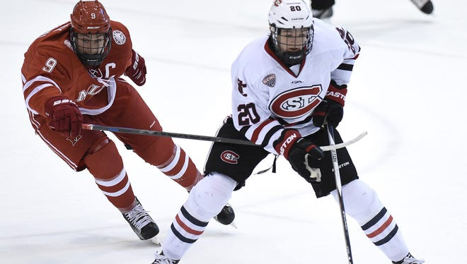 St. Cloud State defenseman Will Borgen (20) carries the puck against Miami's Sean Kuraly (9) earlier this season at the Herb Brooks National Hockey Center. Borgen played on Team USA with Miami's Louie Belpedio in the IIHF World Junior Championships and helped win a bronze medal.