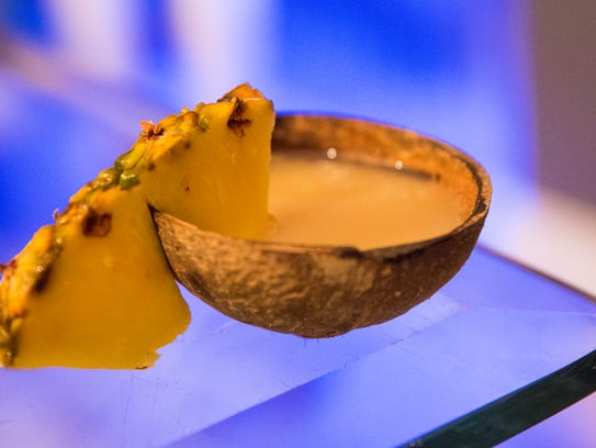 A shell of cool, fresh kava, garnished with pineapple,