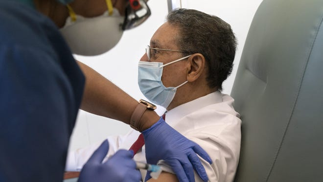 The Rev. Wallace Charles Smith, 72, a pastor at Shiloh Baptist Church, receives his first COVID-19 vaccination from nurse Michelle Martin at United Medical Center in southeast Washington on Wednesday.