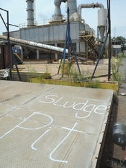 """The term """"sludge pit"""" is marked to identify an area"""