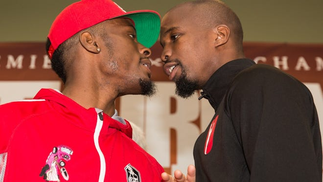 Tony Harrison, left, and Willie Nelson face off and exchange angry words on Thursday during the final news conference for Saturday's fight.  (Photo: Lucas Noonan, PBC)