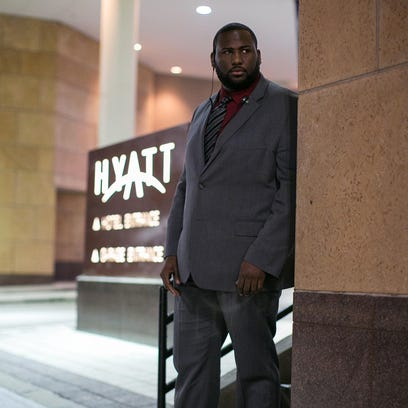 Marcus Dunn is a security guard at the Hyatt Regency in Rochester on Friday, November 13, 2015.