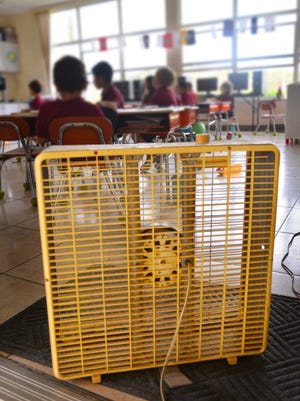 About half the classrooms at Divine Mercy Catholic Academy on Merritt Island were without power Monday and Tuesday. The school has adapted to the situation, adding box fans to classrooms and moving all the middle school students into the air conditioned library.