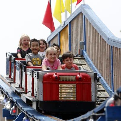 Children ride the Kiddie Coaster at Playland.