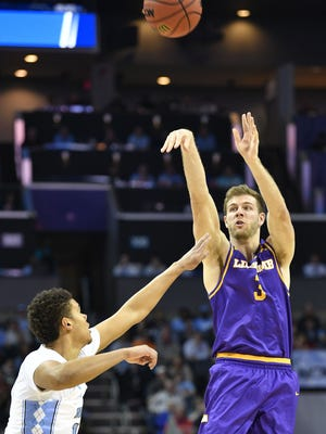 Lipscomb guard Michael Buckland (3) tries for 3 points as Lipscomb plays North Carolina in the 2018 NCAA Men's Basketball Tournament Friday March 16, 2018, in Charlotte, NC