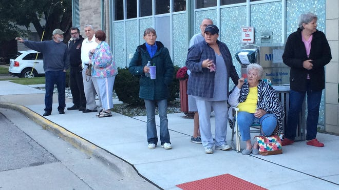 Evacuees from the Sept. 15, 2014 fire at the Leo L. Paluch Senior Citizen Housing complex in Allen Park took shelter at the next-door Allen Park Public Library as firefighters extinguished hot spots.