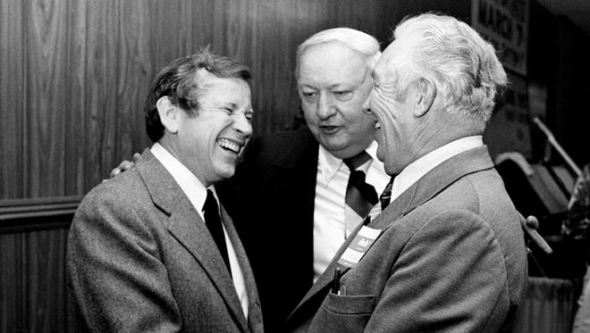 """U.S. Sen. Howard Baker, left, is one of the few Republicans who showed up March 2, 1978 for the 24th annual Sure Shot Rabbit Hunters Association supper at the State Fairgrounds, a political affair usually dominated by such Democrats as Sheriff Fate Thomas and Police Lt. Charles E. """"Goose"""" Warren."""