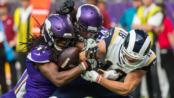 Minnesota Vikings safety Anthony Harris forces a fumble on Los Angeles Rams wide receiver Cooper Kupp during the second quarter at U.S. Bank Stadium.