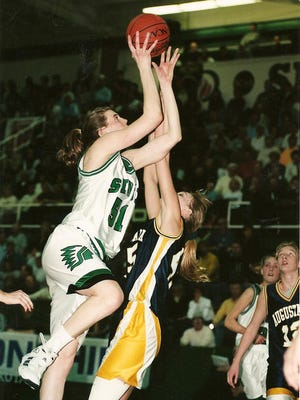 Freeport graduate Jenny Crouse (51) is the all-time leading scorer (2,284 points) and percentage shooter (.624) at the University of North Dakota, which she led to three consecutive NCAA Division II titles and is now a Division I program.