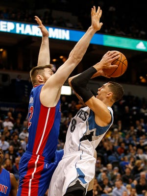 Timberwolves guard Zach LaVine (8) goes and shoots against Pistons forward Aron Baynes (12) in the third quarter Friday in Minneapolis.
