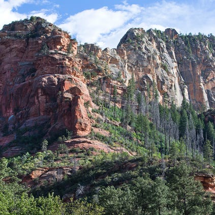 The mountains above Slide Rock State Park in Oak Creek Canyon are majectic over the Arizona landmark.