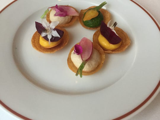 Arpège restaurant in Paris, known for its vegetarian cooking, sends out vegetable mousse tartlets.