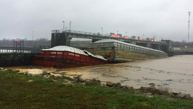 One of two barges pinned against Stennis Lock and Dam in Columbus, Miss. is sinking.