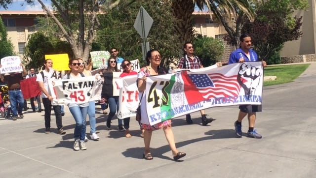 UTEP students, activists and civic leaders marched Friday to protest the lack of information about the 43 students from Ayotzinapa who went missing a year ago.