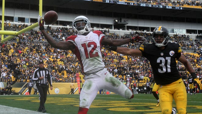 Oct 18, 2015: Arizona Cardinals wide receiver John Brown (12) attempts to catch a pass in the end zone in front of Pittsburgh Steelers cornerback Ross Cockrell (31) during the second half at Heinz Field. The pass was incomplete. The Steelers won the game, 25-13.
