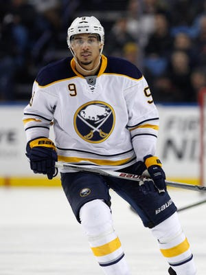 A New York judge plans to dismiss charges against Sabres forward Evander Kane provided he stays out of future trouble.