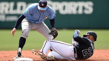 Atlanta Braves outfielder Nick Markakis slides into second base as Tampa Bay Rays infielder Brad Miller looks for the ball during Monday's spring training game.