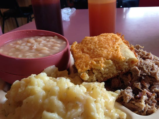 Meat-and-two and a slab of cheese cornbread make for