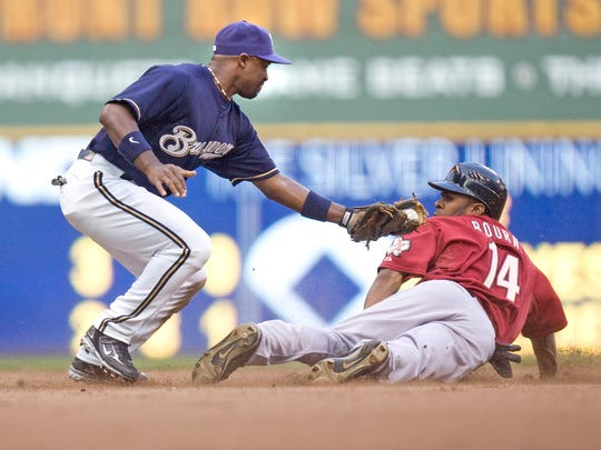 Ray Durham of the Milwaukee Brewers, left, tags out Houston Astros' Michael Bourn on a steal attempt July 26, 2008.