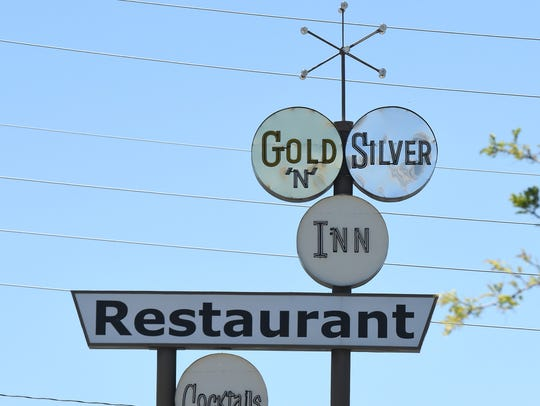 The distinctive sign at the Gold 'N Silver Inn has