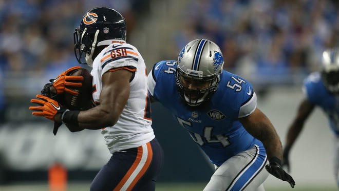 Detroit Lions DeAndre Levy tackles the Chicago Bears Ka'Deem Carey during first half action on Thursday, November 27, 2014 at Ford Field.
