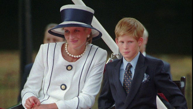 Princess Diana with her younger son Prince Harry on Aug. 19, 1995 in London.