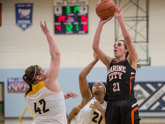 Marine City's Stephanie Abraham takes a shot during